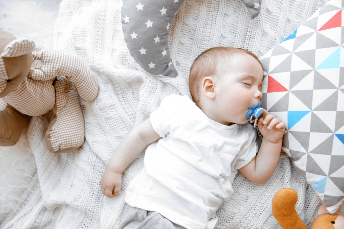 what clothes should a newborn sleep in