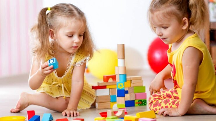 girls playing with toys